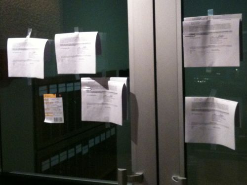 Subpoenas taped to my building's main entrance doors