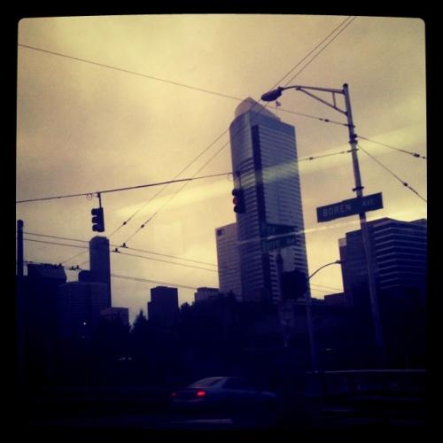 Seattle skyline viewed from a bus crossing Boren & Pine