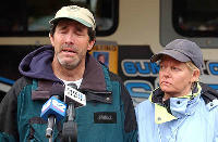 Kevin Bardsley, with his wife Heidi, gives an emotional statement to the press at the command center near Mirror Lake in the Uintah Mountains. (Paul Fraughton/The Salt Lake Tribune)