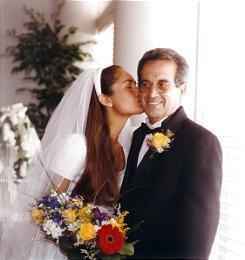 Bride Lori Hacking kisses her father, Eraldo Soares