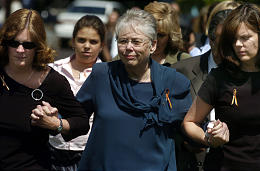 Thelma Soares, center, walks with nieces Jane, left, and Kathy Black at a service for Lori Hacking at an LDS stake center in Orem Saturday. (Michael Brandy, Deseret Morning News)