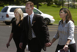 Tiffany Carpenter with brother Lance Hacking and his wife, Stephanie. (Michael Brandy, Deseret Morning News)